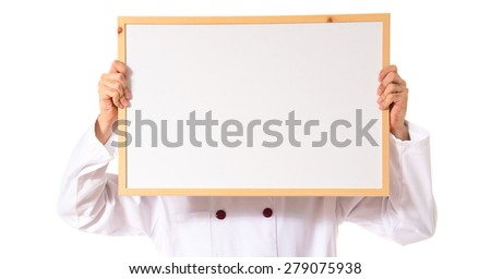 Chef holding empty placard - stock photo