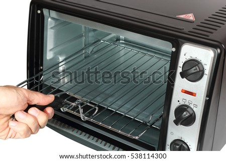 Chef holding grill oven. Isolated with clipping path.