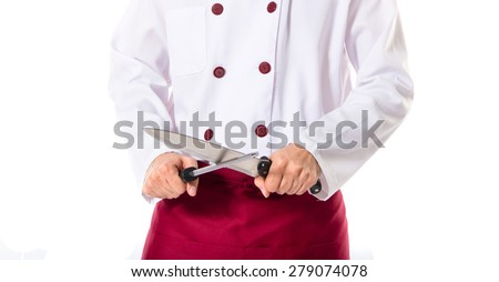 Chef holding knives - stock photo