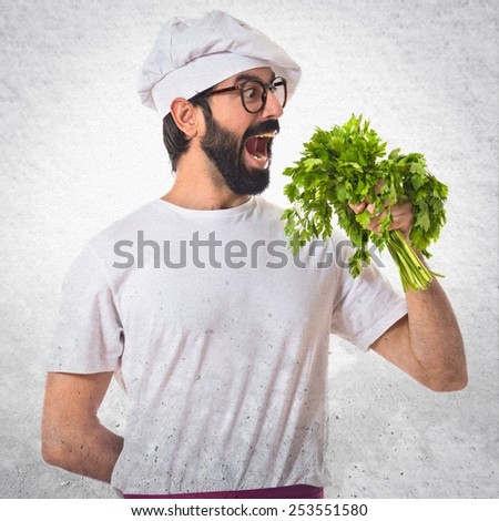 Chef holding lettuce over white background - stock photo