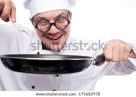 chef holding pan and fork isolated on white background - stock photo