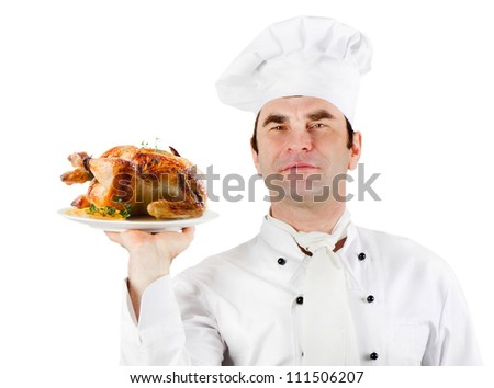 Chef holding  plate with roasted chicken isolated over white background