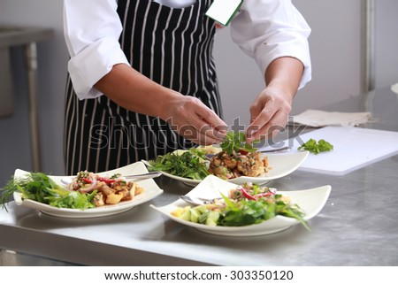 Chef in restaurant kitchen cooking
