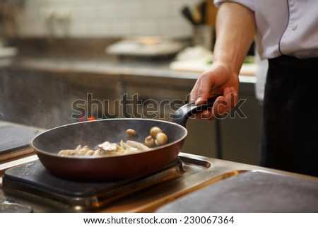 Chef is cooking - stock photo