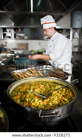 Chef is preparing meals at restaurant kitchen