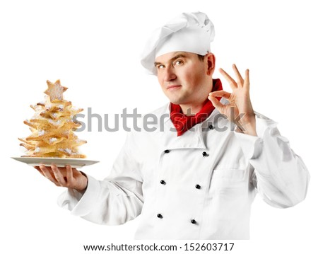 Chef isolated on white with christmas tree of cookies