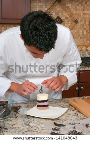 Chef making mousse cake and decorating