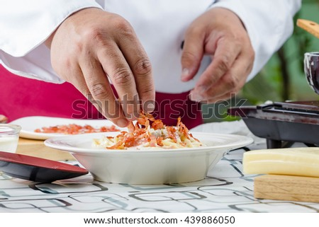 chef making spaghetti  carbonara with bacon