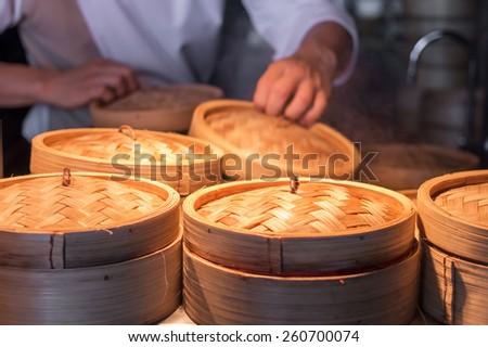 Chef making steam Dim Sum - stock photo