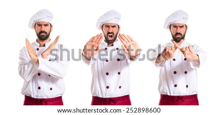 Chef making stop sign over white background - stock photo