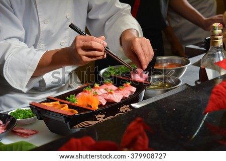 Chef making sushi on boat