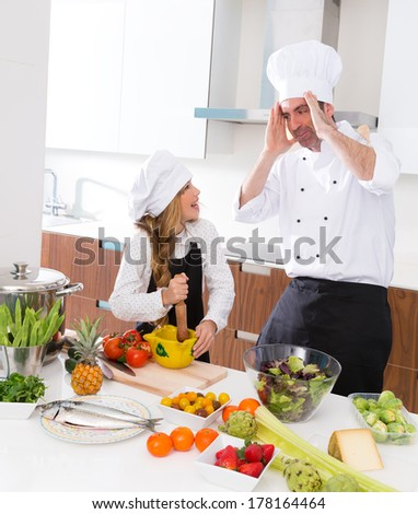 Chef master and junior kid girl at cooking school crazy man about pupil recipe - stock photo