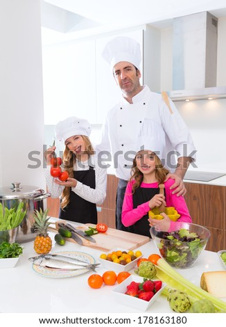 Chef master and junior pupil kid girls at cooking school with food on countertop - stock photo