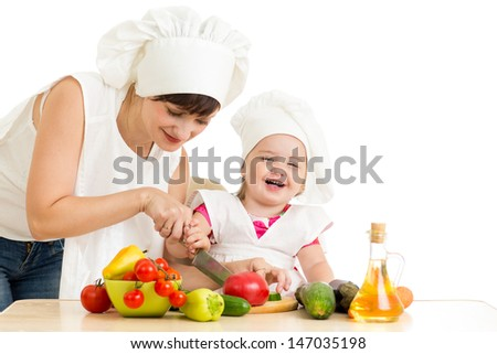 Chef mom and kid preparing healthy food - stock photo