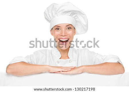 Chef or baker woman showing sign billboard excited smiling happy presenting menu or your copy isolated on white background. Multicultural Asian / Caucasian female chef in chef uniform and hat. - stock photo