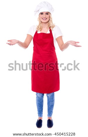 Chef posing in uniform with her arms wide open.