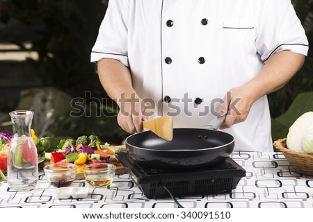 Chef prepared cooking stir fried mixed vegetable  - stock photo