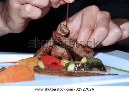 Chef preparing a delicious dish - stock photo