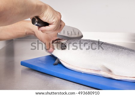 Chef preparing a fresh salmon
