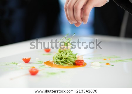 Chef preparing a pasta dish - stock photo