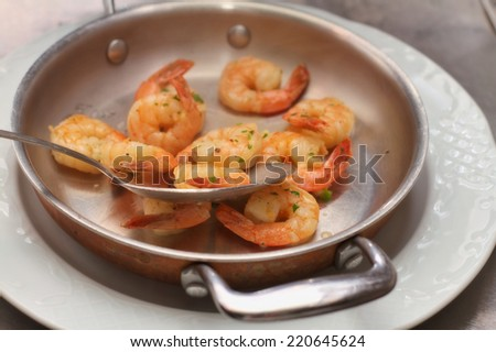 chef preparing a shrimp dish - stock photo