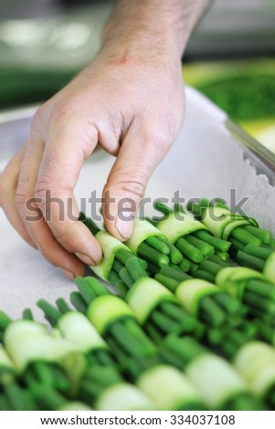 chef preparing courgette vegetables