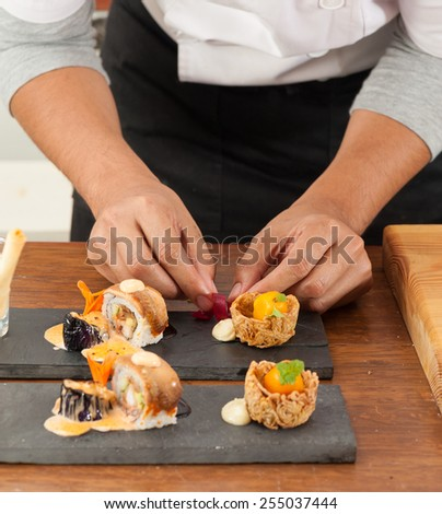 chef preparing for Japanese fusion food set - stock photo