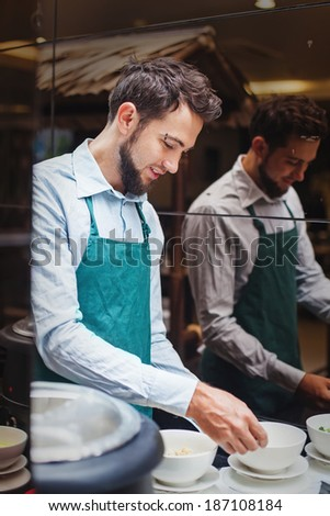 Chef preparing ingredients for cooking - stock photo