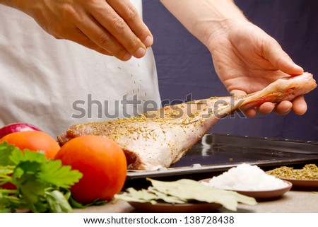 Chef preparing the meat a lamb - stock photo