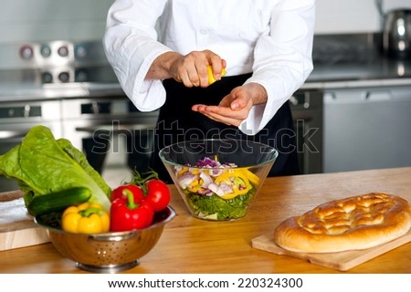 Chef preparing the vegetable salad in kitchen