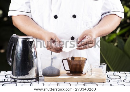 Chef present Ingredient Fresh coffee and Filter cup - stock photo