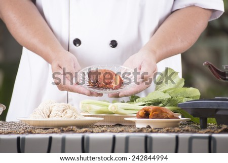 Chef present noodle with noodle ingredient / Cooking Noodle concept - stock photo