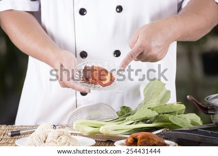 Chef present roasted pork with noodle ingredient / Cooking Noodle concept  - stock photo