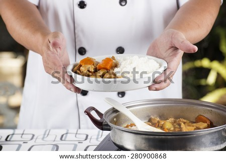Chef presented Japanese pork curry with steam rice / cooking Japanese pork curry paste concept  - stock photo