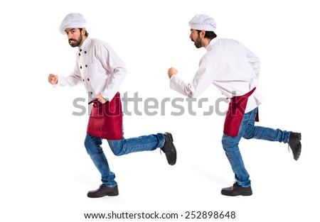 Chef running fast over white background - stock photo