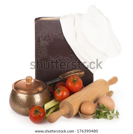 Chef's hat with battledore and cook book  - stock photo