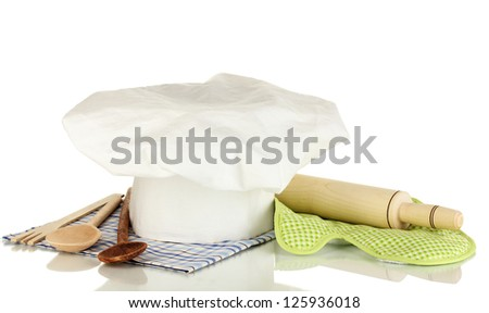 Chef's hat with kitchenware and battledore isolated on white - stock photo