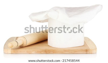 Chef's hat with spoon and battledore isolated on white - stock photo