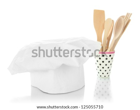 Chef's hat with spoons isolated on white - stock photo