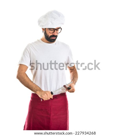 chef sharpening a knife - stock photo