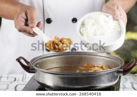 Chef shovel Japanese pork curry with steam rice / cooking Japanese pork curry paste concept  - stock photo