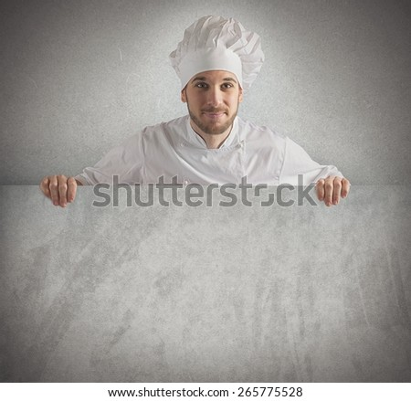 Chef showing his menu on a billboard - stock photo