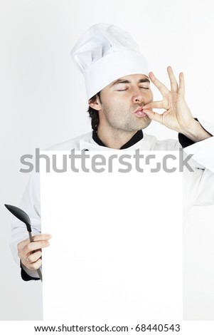 chef showing his restaurants menu - stock photo
