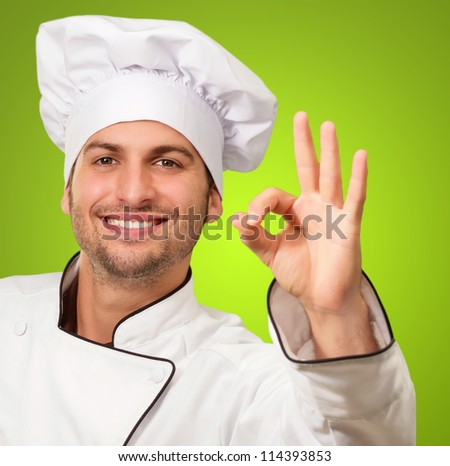 Chef Showing Ok Sign On Green Background