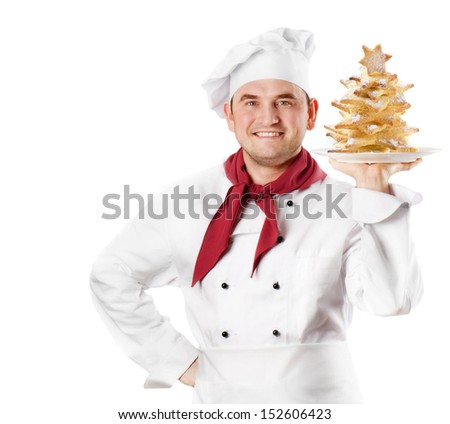 Chef showing  plate with cookies tree  isolated on white