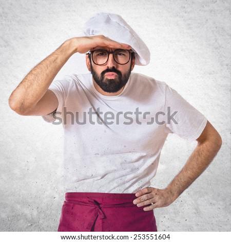 Chef showing something over white background - stock photo