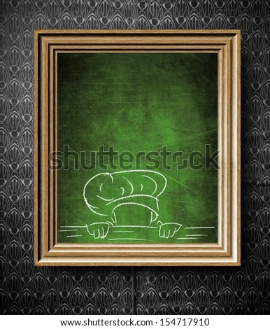 Chef sketch with copy-space for menu chalkboard in old wooden frame on vintage wall - stock photo