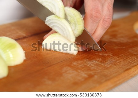 Chef slicing onion. Making Chicken and Egg Galette Series.