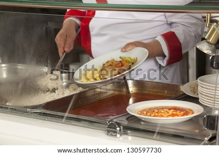 chef standing behind full lunch service station - stock photo