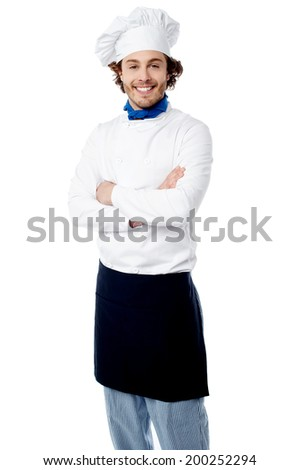 Chef standing on white background with arms crossed - stock photo